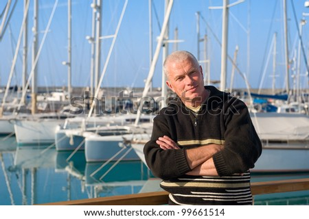 man in front of yachts, marina, North Cyprus - stock photo