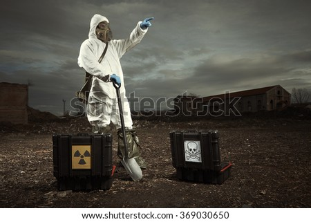 Man in gas mask on dangerous location - stock photo