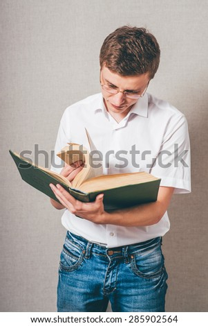 man in glasses reading a big book - stock photo