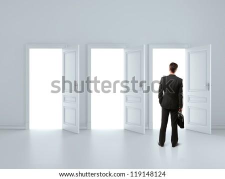 man in gray room with tree open doors - stock photo