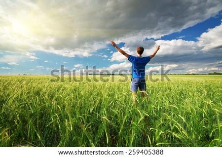 Man in green meadow. Emotional scene. - stock photo