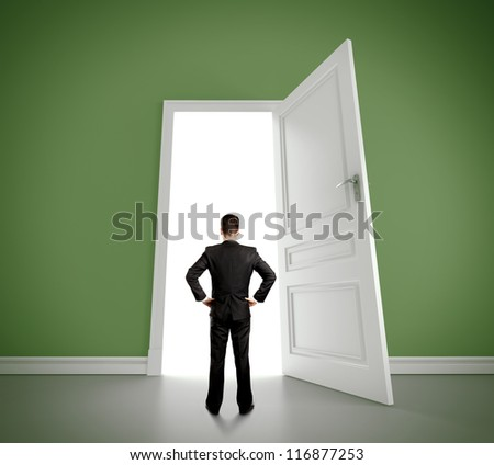 man in green room with doors open