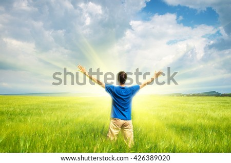Man in green wheat meadow and sunshine. Conceptual design.