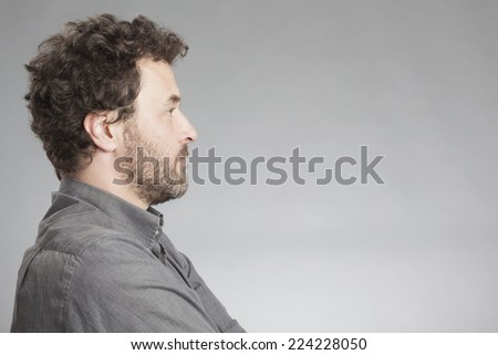 Man in grey shirt, side view