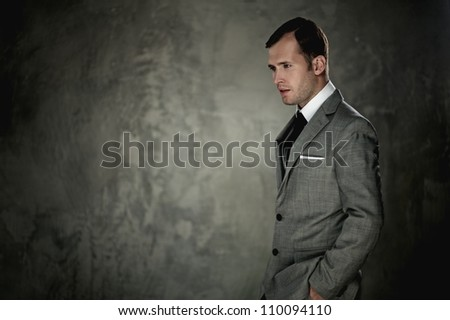 Man in grey suit - stock photo