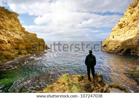 Man in grotto. Composition of nature. - stock photo