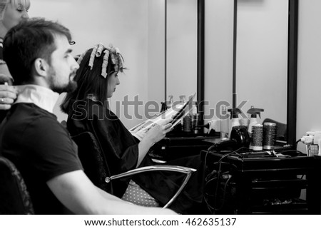 Man in hair doing salon. Black and white view. Waiting for hair cutting
