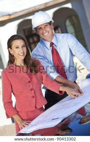 Man in hard hat, shirt and tie with a woman client looking at architectural plans on construction site - stock photo