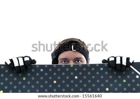 Man in hiding behind snowboard, isolated - stock photo