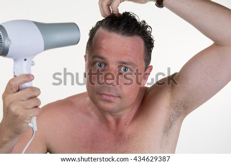 Man in his bathroom on morning with hair dryer