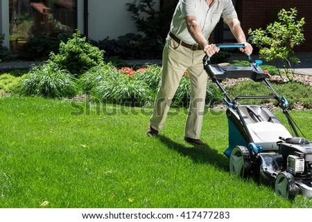 Man in his garden with a lawn mower