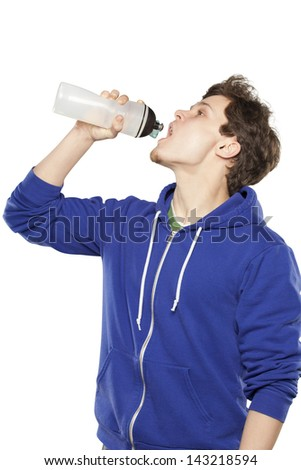 Man in hoodie drinking water isolated background - stock photo