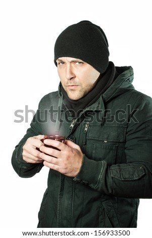 Man in jacket with hot tea