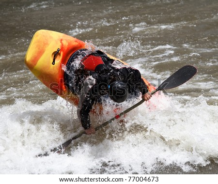 man in kayak, freestyle competition - stock photo