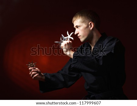 man in kimono with shuriken