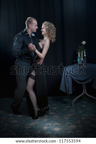 man in love with a girl dancing - stock photo