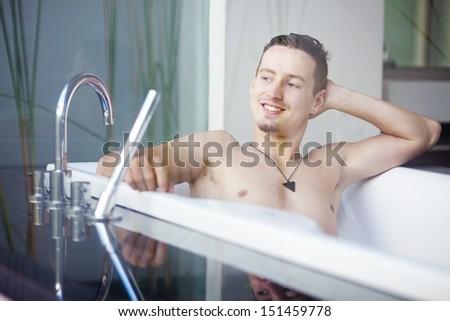 man in luxury bathroom - stock photo