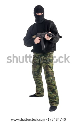 man in mask standing with rifle on white background