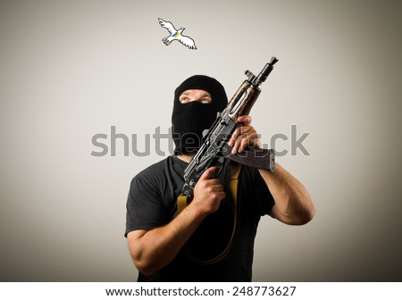 Man in mask with gun and peace dove of Ukraine. Ukraine war concept.