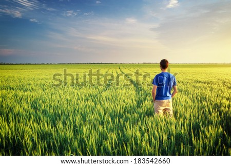Man in meadow green meadow. Conceptual scene. - stock photo