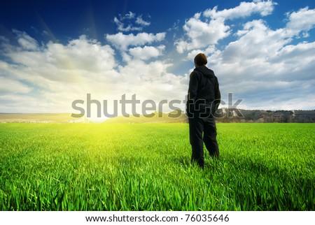 Man in meadow green meadow. Emotional scene. - stock photo