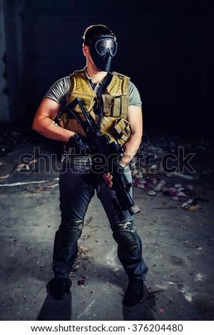 man in military uniform holding a gun - stock photo