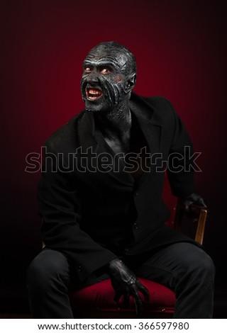 Man in monster makeup - stock photo