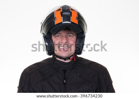 Man in motorcycle outfit and wearing orange and black helmet facing the camera, isolated on white