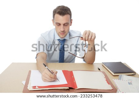 man in office table writing a document - stock photo