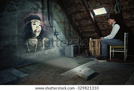 Man in Old Attic Room is Watching a Vintage Woman on Projector-Love Concept