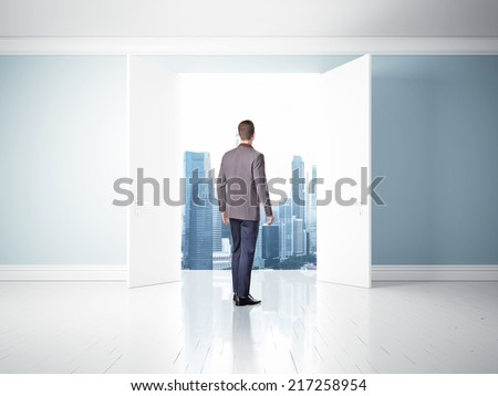 man in open doors, way to success  - stock photo