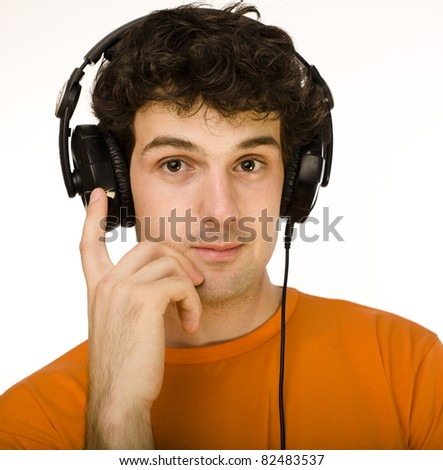man in orange shirt with earphones listening to music - isolated on white - stock photo
