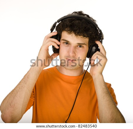 man in orange shirt with earphones listening to music - isolated on white