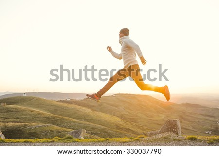 Man in outdoor running and jumping