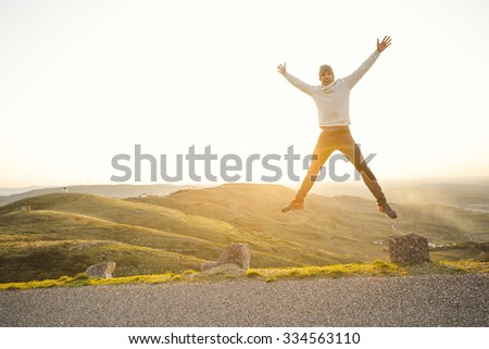 Man in outdoor running and jumping - stock photo