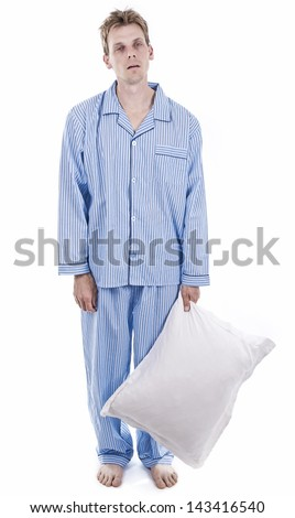 Man in pajamas exhausted - stock photo