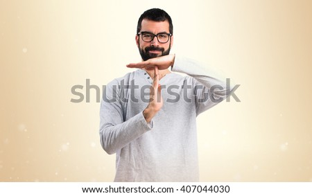 Man in pajamas making time out gesture