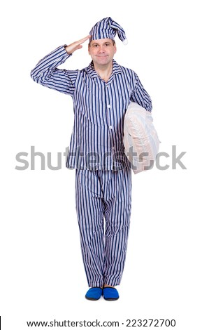 man in pajamas salutes with pillow on white background - stock photo