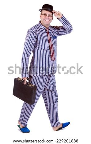 man in pajamas with suitcase  - stock photo