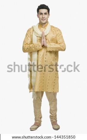 Man in prayer position - stock photo