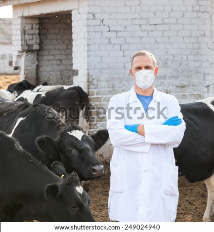 man in protective medical clothing on  farm - stock photo