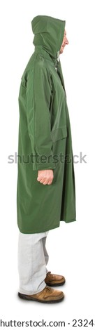 Man in rain green long coat. Side view. Isolated on a white background.