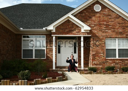 Man in robe and pajamas with coffee and newspaper outside home greeting with hello. - stock photo
