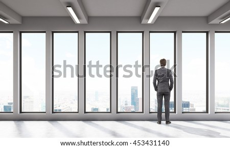 Man in room with big windows watching outside. Concept of thought. 3D render.