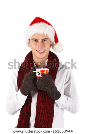 Man in Santa's hat holding christmas cup - stock photo