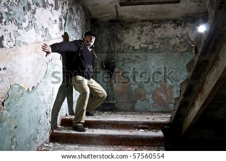 man in scary industrial place - stock photo