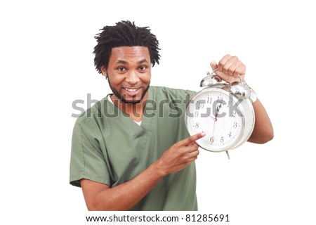 Man in scrubs with large alarm clock showing it is noon. Time for a lunch break! - stock photo
