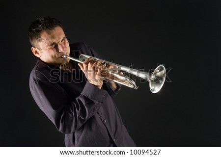 Man in shirt trumpet with might and main. Front view. - stock photo