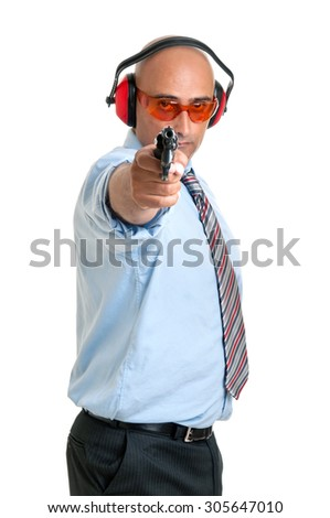 Man in shooting range with gun and goggles