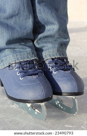 Man in skates standing on ice surface - stock photo